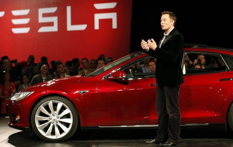 Tesla Reports Record Profit But Cuts Prices